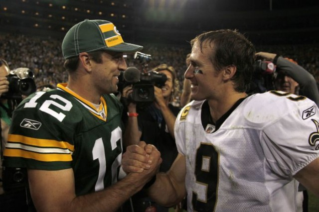 Green Bay Packers quarterback Aaron Rodgers and New Orleans Saints quarterback Drew Brees shake hands after their NFL football game in Green Bay
