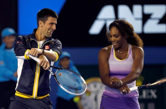 Djokovic of Serbia and Williams of the U.S. dance Gangnam Style during the Kids Tennis Day at the Australian Open tennis tournament in Melbourne