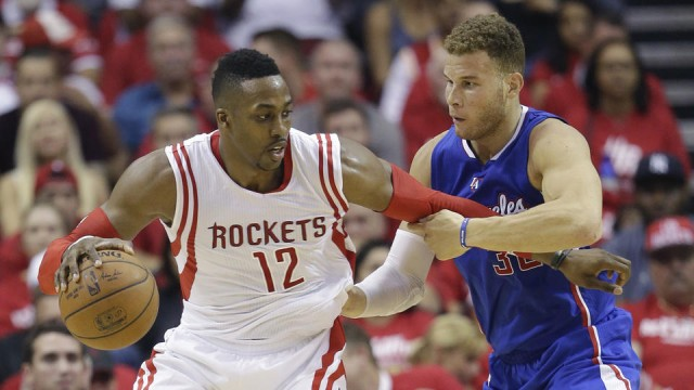 Houston Rockets' Dwight Howard (12) is pressured by Los Angeles Clippers' Blake Griffin (32) during the first half of Game 2 in a second-round NBA basketball playoff series, Wednesday, May 6, 2015, in Houston. (AP Photo/David J. Phillip)