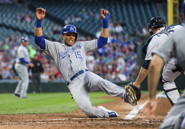 Kansas City's Alex Rios beats the throw home to Seattle catcher Mike Zunino, scoring on the bases-clearing 3-run RBI double by Omar Infante.  (Dean Rutz / The Seattle Times)