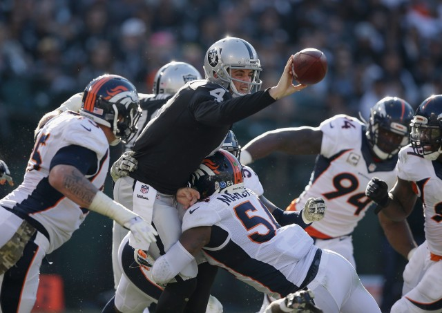 OAKLAND, CA - NOVEMBER 09:  Derek Carr #4 of the Oakland Raiders pitches the ball against the Denver Broncos in the third quarter at O.co Coliseum on November 9, 2014 in Oakland, California.  (Photo by Ezra Shaw/Getty Images)