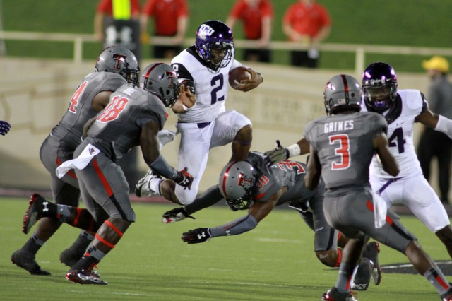 Sep 12, 2013; Lubbock, TX, USA; TCU Horned Frogs quarterback Trevone Boykin (2) rushes against the Texas Tech Red Raiders during the second half at Jones AT&T Stadium. Mandatory Credit: Michael C. Johnson-USA TODAY Sports
