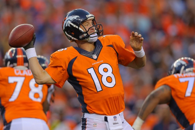 DENVER, CO - AUGUST 23:  Quarterback Peyton Manning #18 of the Denver Broncos throws against the Houston Texans during a preseason game at Sports Authority Field at Mile High on August 23, 2014 in Denver, Colorado.  (Photo by Justin Edmonds/Getty Images)