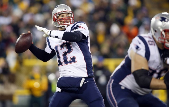 Nov 30, 2014; Green Bay, WI, USA; New England Patriots quarterback Tom Brady (12) passes the ball during the second half against the Green Bay Packers at Lambeau Field. The Packers won 26-21. Mandatory Credit: Chris Humphreys-USA TODAY Sports ORG XMIT: USATSI-180390 ORIG FILE ID:  20141130_jla_aq2_091.jpg