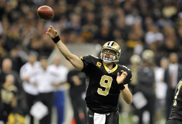 New Orleans Saints quarterback Drew Brees (9) passes during the first quarter of an NFL football game against the New York Giants in New Orleans, Monday, Nov. 28, 2011. (AP Photo/Bill Feig)