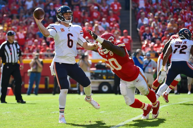 KANSAS CITY, MO - OCTOBER 11:  Jay Cutler (6) of the Chicago Bears throws the ball avoiding the attempted sack of Justin Houston (50) of the Kansas City Chiefs at Arrowhead Stadium during the game on October 11, 2015 in Kansas City, Missouri. (Photo by Peter Aiken/Getty Images)