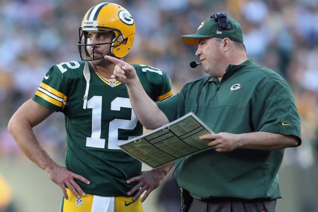 GREEN BAY, WI - SEPTEMBER 30:  Green Bay Packers head coach Mike McCarthy talks with quarterback Aaron Rodgers in the third quarter against the New Orleans Saints at Lambeau Field on September 30, 2012 in Green Bay, Wisconsin. The Packers defeated the Saints 28-27.  (Photo by Jeff Gross/Getty Images)