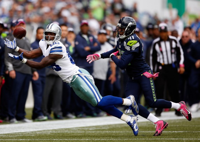 SEATTLE, WA - OCTOBER 12: Wide receiver Dez Bryant #88 of the Dallas Cowboys catches a pass against cornerback Byron Maxwell #41 of the Seattle Seahawks during the first quarter of the game at CenturyLink Field on October 12, 2014 in Seattle, Washington.  (Photo by Otto Greule Jr/Getty Images)