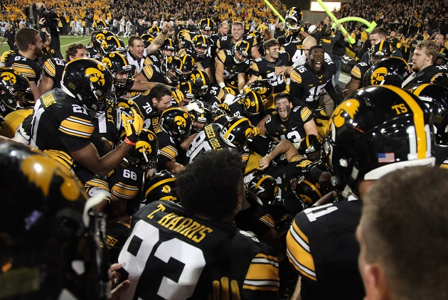 IOWA CITY, IA - SEPTEMBER 19:  Members of the Iowa Hawkeyes celebrate in the end zone after a game winning field goal by kicker Marshall Koehn #1 late in the second half against the Pittsburgh Panthers on September 19, 2015 at Kinnick Stadium, in Iowa City, Iowa.  (Photo by Matthew Holst/Getty Images)