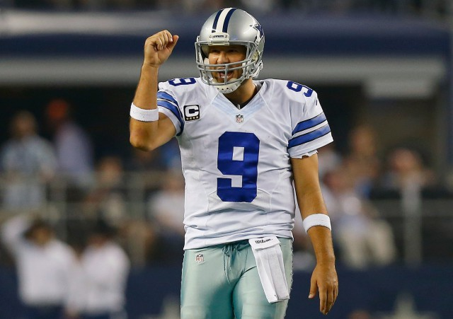 ARLINGTON, TX - SEPTEMBER 28:   Tony Romo #9 of the Dallas Cowboys celebrates a first down against the New Orleans Saints in the second half at AT&T Stadium on September 28, 2014 in Arlington, Texas.  (Photo by Tom Pennington/Getty Images)
