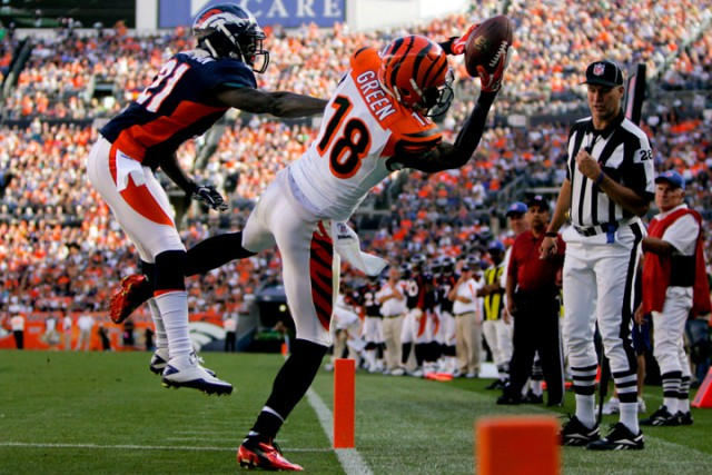 DENVER, CO - SEPTEMBER 18:  Wide receiver A.J. Green #18 of the Cincinnati Bengals makes a catch for a touchdown as Cornerback Andre' Goodman #21 of the Denver Broncos defends during the fourth quarter at Sports Authority Field at Mile High on September 18, 2011 in Denver, Colorado. (Photo by Justin Edmonds/Getty Images) *** Local Caption *** A.J. Green; Andre' Goodman