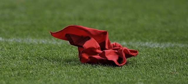 A replay challenge flag is shown during an NFL preseason football game between the San Francisco 49ers and the Denver Broncos in Denver, Sunday, Aug. 26, 2012. (AP Photo/Jack Dempsey)