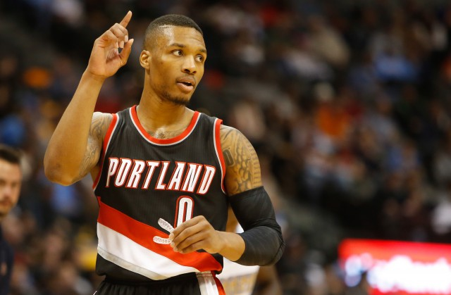 Nov 12, 2014; Denver, CO, USA; Portland Trail Blazers guard Damian Lillard (0) during the game against the Denver Nuggets at Pepsi Center. The Trail Blazers won 130-113.  Mandatory Credit: Chris Humphreys-USA TODAY Sports