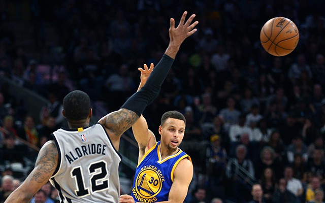 Mar 19, 2016; San Antonio, TX, USA; Golden State Warriors guard Stephen Curry (30) passes over San Antonio Spurs forward LaMarcus Aldridge (12) at the AT&T Center. Spurs won 89-79. Mandatory Credit: Erich Schlegel-USA TODAY Sports