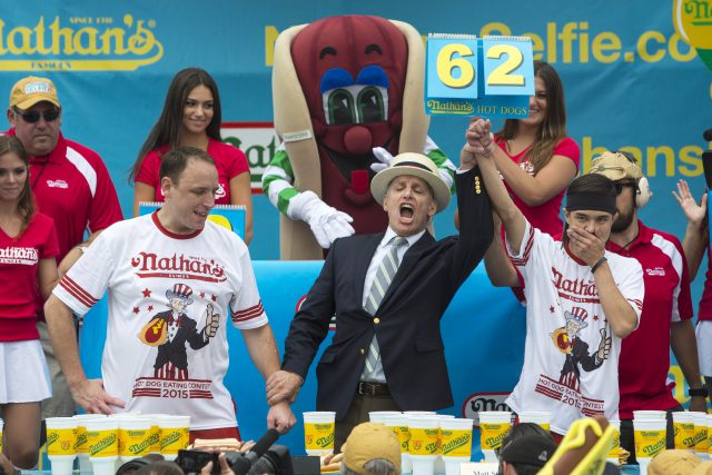 Matt Stonie (R) is crowned winner of the annual Fourth of July 2015 Nathan's Famous Hot Dog Eating Contest in Brooklyn, New York July 4, 2015. Stonie defeated 8 time champion Joey Chestnut 62-60, according to local media. REUTERS/Andrew Kelly - RTX1J0GO