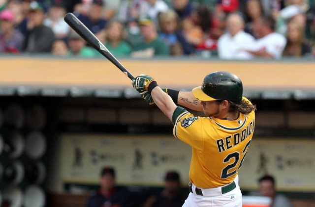 Jul 30, 2015; Oakland, CA, USA; Oakland Athletics right fielder Josh Reddick (22) hits a RBI double against the Cleveland Indians in the first inning at O.co Coliseum. Mandatory Credit: Lance Iversen-USA TODAY Sports
