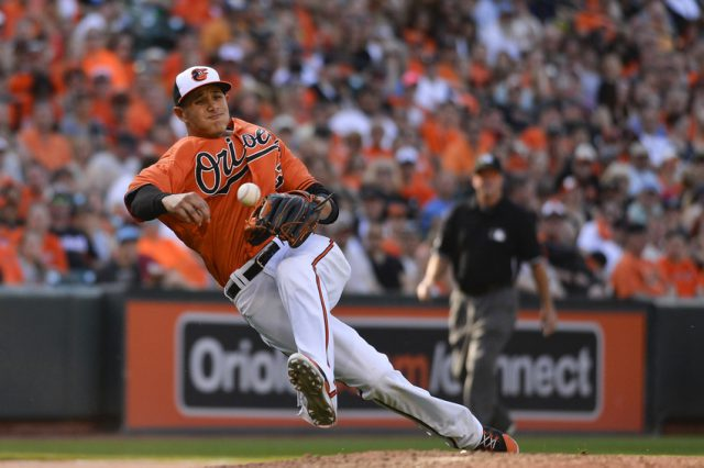 May 30, 2015; Baltimore, MD, USA;  Baltimore Orioles third baseman Manny Machado (13) attempts to throw out Tampa Bay Rays left fielder Brandon Guyer (5) (not pictured) at first base during the eighth inning at Oriole Park at Camden Yards. Tampa Bay Rays defeated Baltimore Orioles 3-0. Mandatory Credit: Tommy Gilligan-USA TODAY Sports