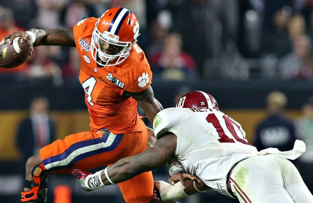 Jan 11, 2016; Glendale, AZ, USA; Clemson Tigers quarterback Deshaun Watson (4) gets away from Alabama Crimson Tide linebacker Reuben Foster (10) during the third quarter in the 2016 CFP National Championship at University of Phoenix Stadium. Mandatory Credit: Matthew Emmons-USA TODAY Sports