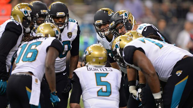 Jacksonville Jaguars quarterback Blake Bortles (5) calls a play in the huddle against the New Orleans Saints in an NFL Game Sunday, Dec. 27, 2015, in New Orleans, La.  (Rick Wilson via AP Images)