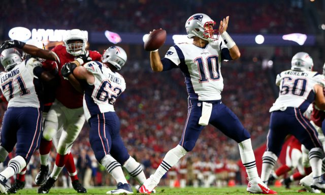 Sep 11, 2016; Glendale, AZ, USA; New England Patriots quarterback Jimmy Garoppolo (10) throws a pass in the second quarter against the Arizona Cardinals at University of Phoenix Stadium. Mandatory Credit: Mark J. Rebilas-USA TODAY Sports