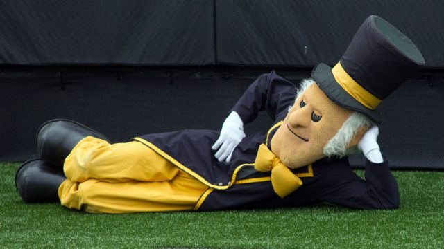 Nov 28, 2015; Winston-Salem, NC, USA; The Wake Forest Demon Deacons mascot lays on the turf in the endzone during the second quarter against the Duke Blue Devils at BB&T Field. Mandatory Credit: Jeremy Brevard-USA TODAY Sports
