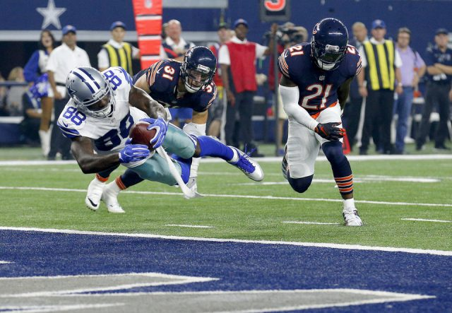 Dallas' Dez Bryant (88) dives for a touchdown in front of Chicago's Chris Prosinski (31) and Chicago's Tracy Porter (21) during the NFL football game between the Dallas Cowboys and the Chicago Bears at AT&T Stadium in Arlington, Texas, Sunday, Sept. 25, 2016. Photo by Sarah Phipps, The Oklahoman