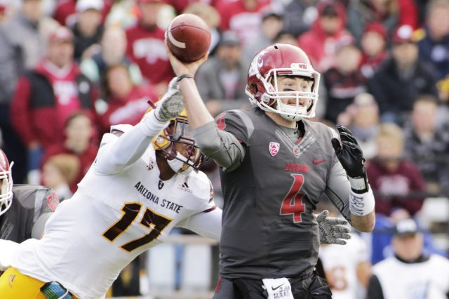 Washington State quarterback Luke Falk (4) passes as he is hit by Arizona State linebacker Ismael Murphy-Richardson (17) during the first half of an NCAA college football game, Saturday, Nov. 7, 2015, in Pullman, Wash. (AP Photo/Young Kwak)