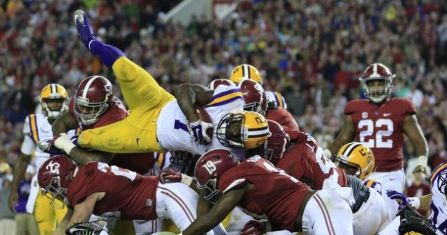 Nov 7, 2015; Tuscaloosa, AL, USA; LSU Tigers running back Leonard Fournette (7) leaps over Alabama Crimson Tide defense during the fourth quarter at Bryant-Denny Stadium. Alabama won 30-16. Mandatory Credit: Marvin Gentry-USA TODAY Sports