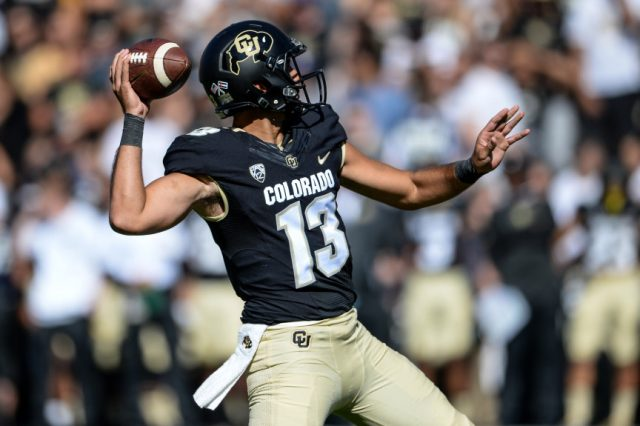 BOULDER, CO - SEPTEMBER 10:  Quarterback Sefo Liufau #13 of the Colorado Buffaloes throws for a first quarter touchdown against the Idaho State Bengals at Folsom Field on September 10, 2016 in Boulder, Colorado.  (Photo by Dustin Bradford/Getty Images)