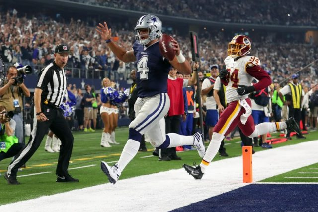 ARLINGTON, TX - NOVEMBER 24:   Dak Prescott #4 of the Dallas Cowboys rushes for a touchdown during the fourth quarter against the Washington Redskins at AT&T Stadium on November 24, 2016 in Arlington, Texas.  (Photo by Tom Pennington/Getty Images)