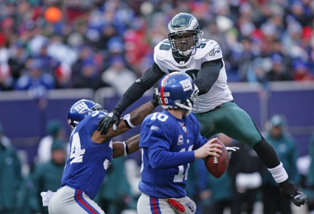 EAST RUTHERFORD, NJ - JANUARY 11: Defensive end Trent Cole #58 of the Philadelphia Eagles rushes quarterback Eli Manning #10 of the New York Giants during the NFC Divisional Playoff game on January 11, 2009 at Giants Stadium in East Rutherford, New Jersey. The Eagles defeated the Giants 23-11. (Photo by Hunter Martin/Getty Images)