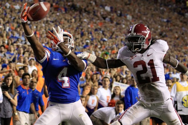 GAINESVILLE, FL - OCTOBER 01:  Andre Debose #4 of the Florida Gators attempts to make a reception against Dre Kirkpatrick #21 of the Alabama Crimson during a game at Ben Hill Griffin Stadium on October 1, 2011 in Gainesville, Florida.  (Photo by Sam Greenwood/Getty Images)