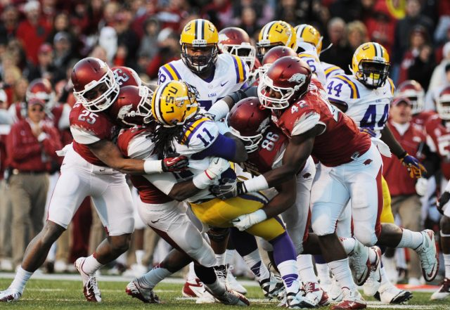 Sarah Bentham • Arkansas News Bureau   Arkansas' defense swarms to tackle LSU running back Spencer Ware in the second half Friday, Nov. 23, 2012, at Donald W. Reynolds Razorback Stadium in Fayetteville.