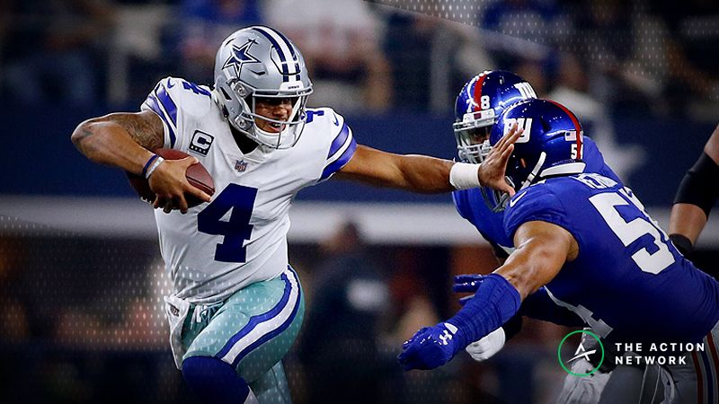 Dallas Cowboys quarterback Dak Prescott (4) breaks a tackled by New York Giants defensive end Romeo Okwara (78) and defensive end Olivier Vernon (54) in the second quarter at AT&T Stadium.