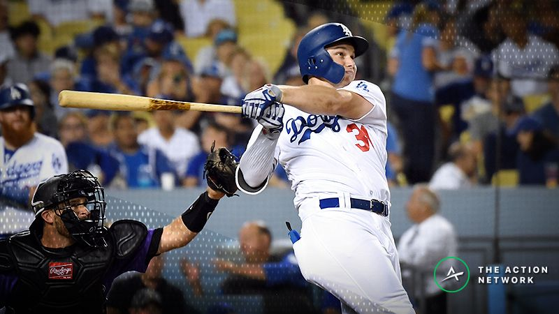 Los Angeles Dodgers left fielder Joc Pederson (31) hits a two run home run against the Colorado Rockies during the fourth inning at Dodger Stadium.