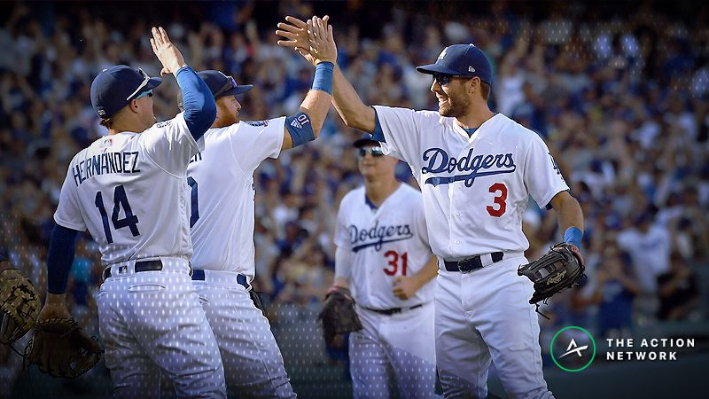 Los Angeles Dodgers center fielder Chris Taylor (3) and third baseman Justin Turner (10) celebrate the victory following the National League West division tiebreaker game at Dodger Stadium.