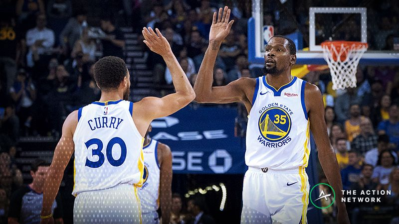 Golden State Warriors forward Kevin Durant (35) and guard Stephen Curry (30) celebrate against the Phoenix Suns during the first quarter at Oracle Arena.