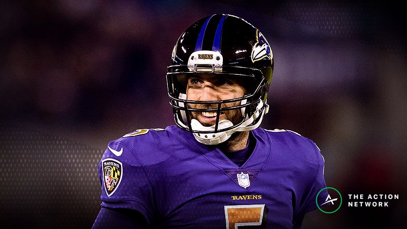 Baltimore Ravens quarterback Joe Flacco (5) celebrates after wide receiver Jeremy Maclin (not pictured) scored a touchdown against the Miami Dolphins in the first quarter at M&T Bank Stadium.