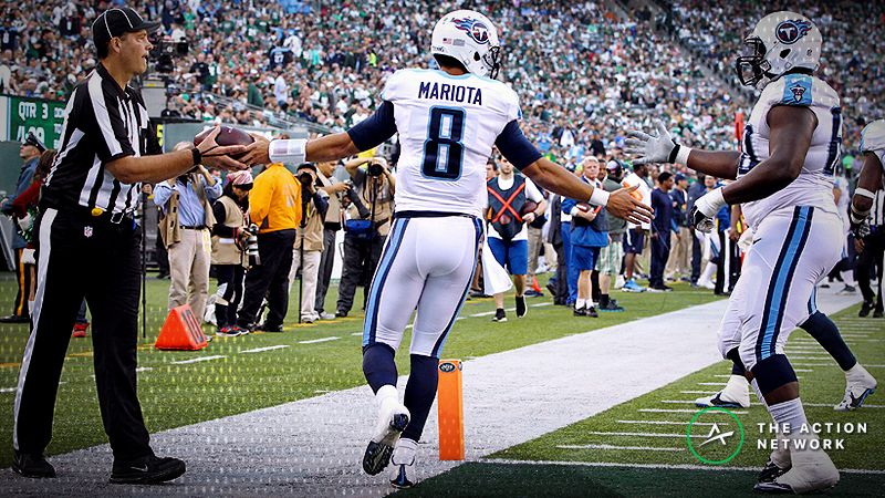 Tennessee Titans quarterback Marcus Mariota (8) celebrates after a touchdown reception against the Tennessee Titans at MetLife Stadium.