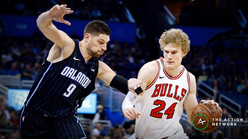 Chicago Bulls forward Lauri Markkanen (24) drives around Orlando Magic center Nikola Vucevic (9) during the first quarter at Amway Center.